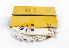 Gold and lots of money Royalty Free Stock Image