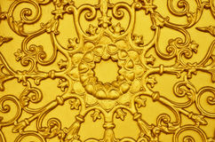 Gold lotus low relief. On the gate Royalty Free Stock Images