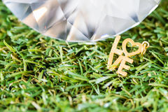 Gold love word in garden Royalty Free Stock Photos