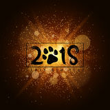 Gold luminous dust on a black background. Trace from the dog. Happy new year 2018. Cover for the calendar. Vector illustration Stock Photos
