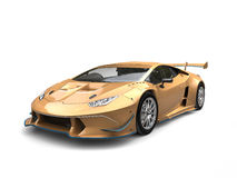 Gold luxury super car with blue details - beauty shot Royalty Free Stock Photo