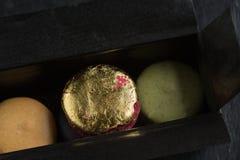 Gold macaron Royalty Free Stock Image