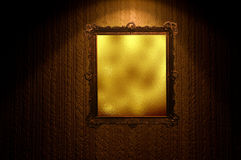 Gold magic mirror on grunge wall Stock Images