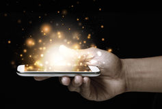 Gold magic stars light on smartphone Royalty Free Stock Images
