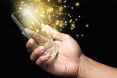 Gold magic stars light on smartphone Stock Photo