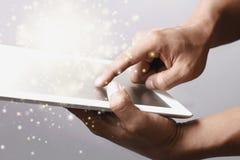 Gold magic stars light on tablet Stock Photos