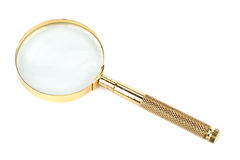 Gold magnifier Stock Photos