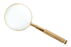 Gold magnifier Royalty Free Stock Image