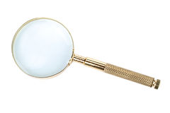 Gold magnifier Stock Image