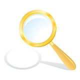 Gold magnifying glass Stock Photos