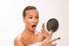 Gold make up. Brown sleek hair beautiful woman looking at mirror Royalty Free Stock Images