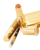 Gold make up collection isolated on black background Stock Photos
