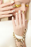 Gold manicure . Royalty Free Stock Image