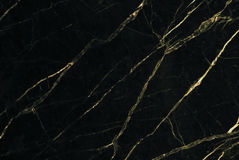 Gold marble texture with natural pattern for background or design art work.