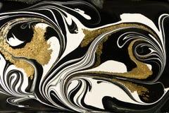 Gold marbling texture design. Black and golden marble pattern. Fluid art. Gold marbling texture design. Black and golden marble pattern. Fluid art stock photos