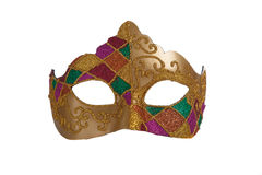 Gold mardi gra mask. A gold mardi gra mask with green and purple beads on a white background
