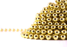 Gold mardi gras. Mountain on white background Royalty Free Stock Photography