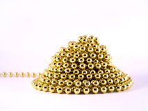 Gold mardi gras beads. Gold mardi gras shaped like mountain Royalty Free Stock Images