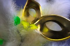 Gold mask. And feathers, shallow DOF stock image