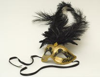 Gold mask with feathers. Gold mask with black feathers Royalty Free Stock Photos