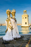 Gold masked twin sisters. At Venice Carnival Royalty Free Stock Image