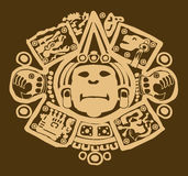 Gold Mayan design on brown. Close up of ornate gold gilt Mayan design on brown Stock Photography
