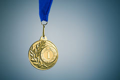Gold medal. And copy-space, blue background Royalty Free Stock Photos