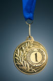 Gold medal. Against the blue background - the symbol of victory Stock Image