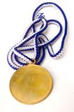 Gold medal. A gold medal on a white background stock image