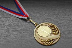 Gold medal. With ribbon on grey background Royalty Free Stock Photography