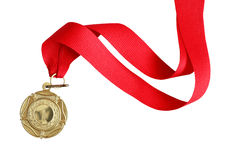 Gold Medal. With red ribbon on white background. Clipping path is included Stock Images