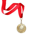 Gold Medal. With red ribbon on white background. Clipping path is included Stock Photos