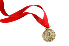 Gold Medal. With nice long red ribbon on white background. Isolated with clipping path Stock Photography