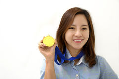 Gold medal. Young Businesswoman holds up her gold medal Royalty Free Stock Photography