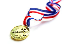 Gold medal. Champion gold medal and ribbon, closeup on white Royalty Free Stock Images
