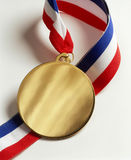 Gold Medal award with lanyard. A blank gold medal with red,white and blue lanyard Royalty Free Stock Photo