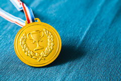 Gold medal. On blue background Stock Photo