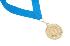 Gold medal with blue ribbon isolated. On white background Stock Images