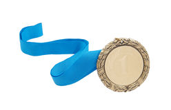 Gold medal with blue ribbon isolated. On white background Royalty Free Stock Photos