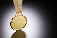 Gold medal. Close up of the golden medal stock photography