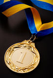 Gold medal on a dark background Stock Photo