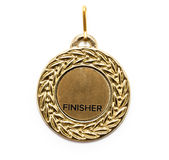 Gold medal. Finisher gold medal isolated on white Royalty Free Stock Photography