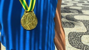 Gold Medal First Place Brazilian Athlete Rio. Brazilian gold medal first place athlete standing with palm frond shadows at the Ipanema Beach sidewalk in Rio de stock video