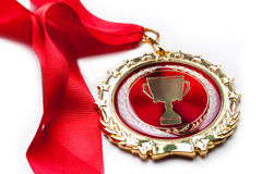 Gold medal. First place winner award goal medalist ribbon the best laurel Stock Photos