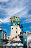 Gold Medal Flower Sign and Mill City Museum. Historic Gold Medal Flower signage on top of the old flour mill with the new modern Mill City Museum located in the Stock Photos
