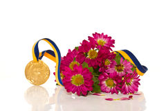 Gold medal with flowers Royalty Free Stock Images