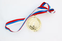 Gold medal in fresh snow Royalty Free Stock Image