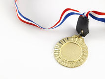 Gold medal. Golden medal on the white background Stock Photography
