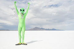 Gold Medal Green Alien Standing on White Planet Stock Photography