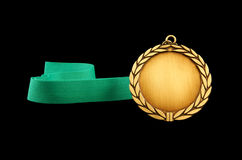 Gold medal with green ribbon Royalty Free Stock Photography